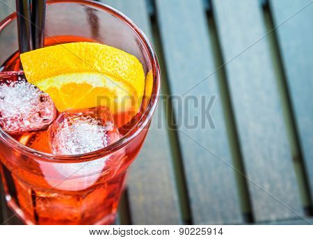 Top Of View Of Spritz Aperitif Aperol Cocktail With Two Orange Slices And Ice Cubes