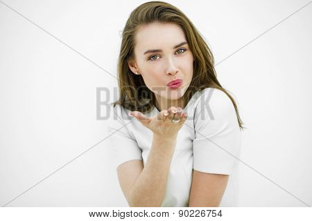 Blow kiss, young caucasian female model isolated on white background