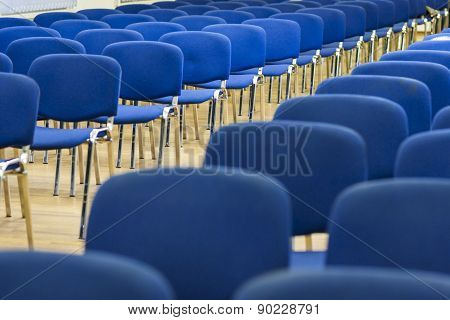 Row Of Modern Chairs Standing In Line In The Empty Auditorium.