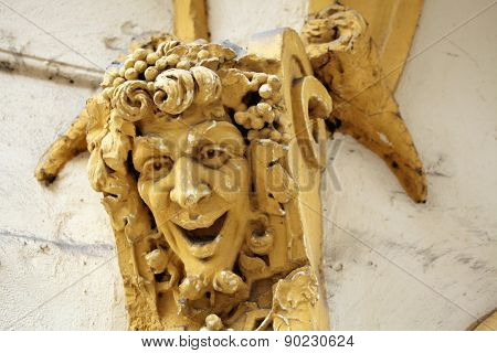 Drunken Bacchus. Stucco mascaron on the Art Nouveau building in Prague, Czech Republic.