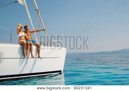 Couple in love on a sail boat in the summer.