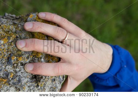 Hand Holds On Stone