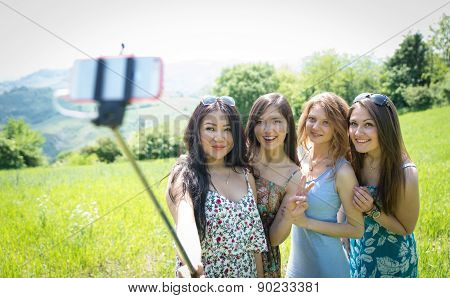 Group Of Girls Making Selfie With Selfie Stick