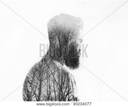 Double exposure portrait of a bearded guy