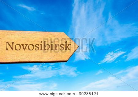 Wooden arrow sign pointing tourist destination