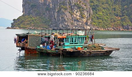People On A Fishing Boat In Ha Long Bay, Vietnam