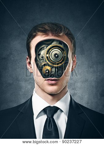 business man with gears inside head on the gray background