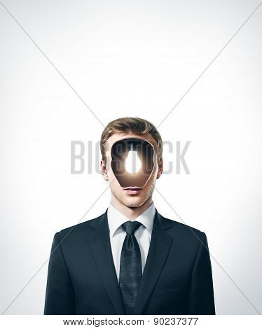 businessman with lamp inside head