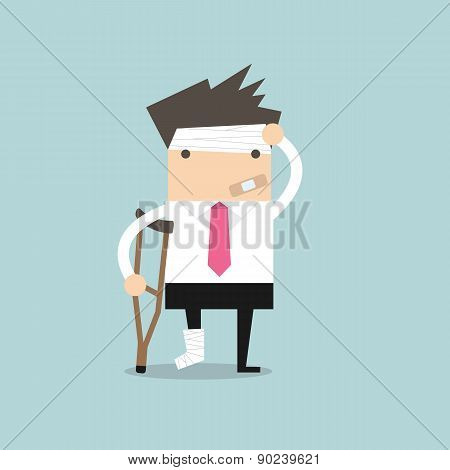 Businessman injured standing with crutches