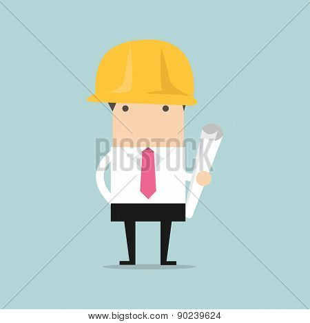 Architect or engineer in yellow safety helmet with building project blueprints rolls