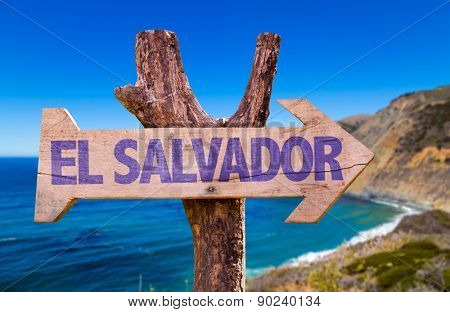 El Salvador wooden sign with coast background