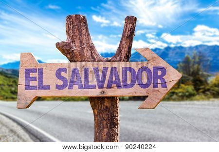 El Salvador wooden sign with road background