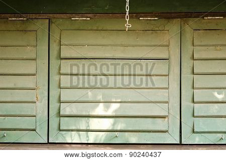 Closed Green  Wooden Windows