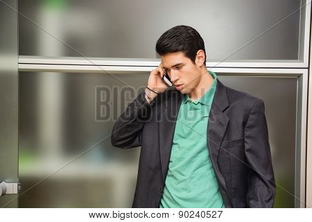 Handsome young businessman talking on cell phone