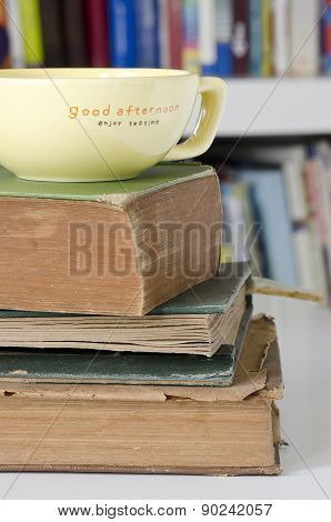 Old Books And Yellow Cup