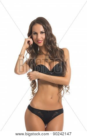 Pretty long-haired model posing in erotic lingerie
