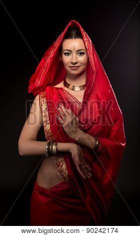 Image of beautiful bride in traditional sari