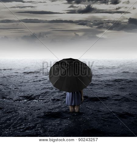 Backview Of Woman Alone At The Sea