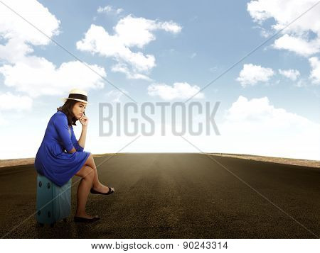 Beautiful Woman Waiting Alone On The Road