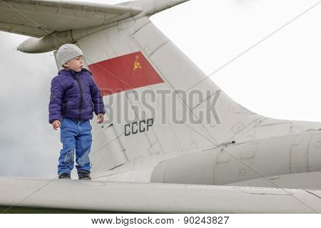 Child On The Wing Of A Jet Plane