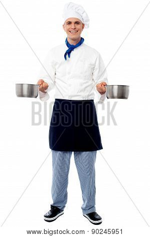 Young Male Chef Holding Empty Vessels