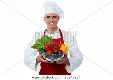 Male Chef Holding Vegetables Bowl