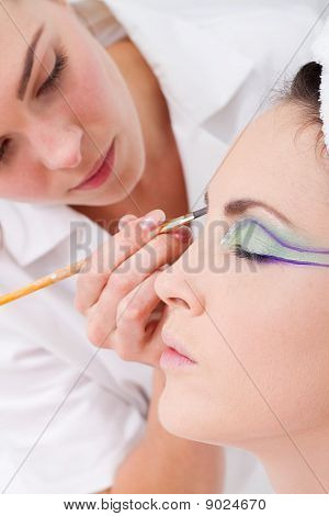 model having eye make up done