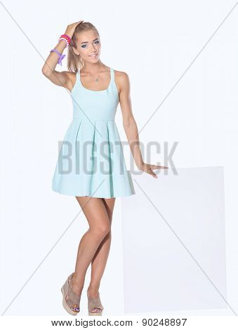 Young woman with blank board banner, isolated on white background.