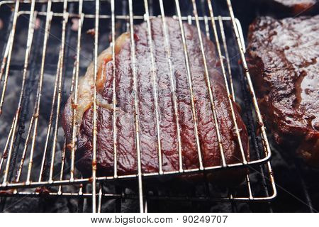 grilled roast meats beef lamb fillet ribs on bbq grid over charcoal