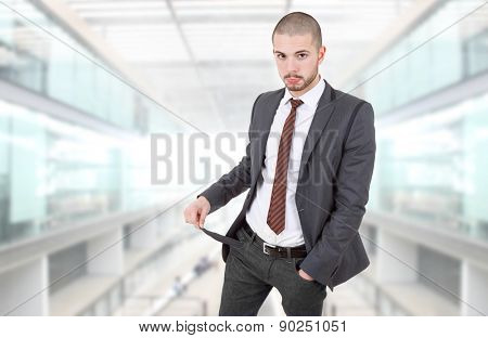 business man showing his empty pocket, at the office
