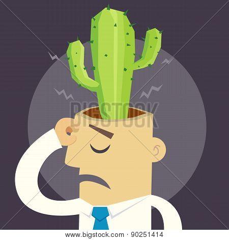Businessman has cactus in head