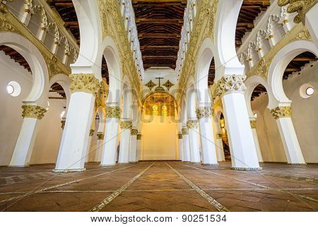 TOLEDO, SPAIN - NOVEMBER 11, 2014: Santa Maria La Blanca Church. Originally known as the Ibn Shushan Synagogue, it is disputably considered the oldest synagogue building in Europe still standing.