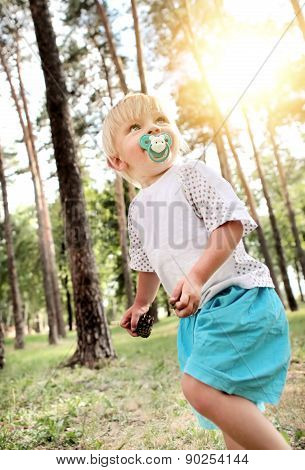 Child Walking In The Forest