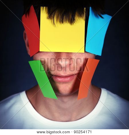 Man With Papers On The Face
