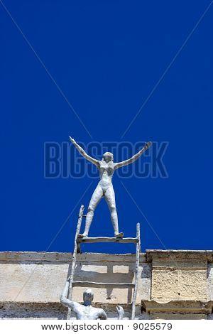 Metallic Man Is On Roof