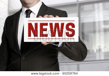 Businessman Holding News Sign To Viewer