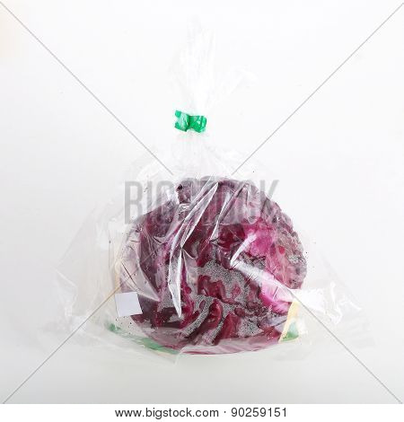 Red Cabbage Wrapped In A Plastic Bag