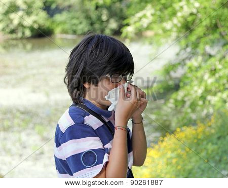 Boy With Pollen Allergy With Handkerchief In Hand