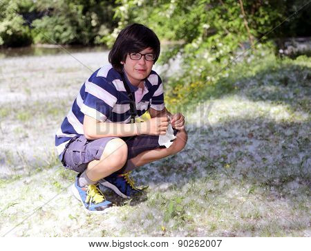 Young Boy With Pollen Allergy With White Handkerchief