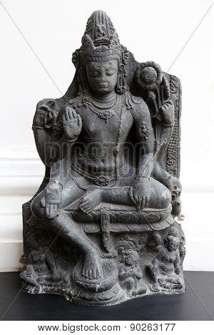 KOLKATA, INDIA - FEBRUARY 15: Six armed Avalokitesvara, from 10th century found in Basalt Nalanda, Bihar now exposed in the Indian Museum in Kolkata, on February 15, 2014