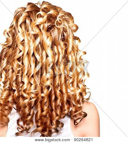 Beauty girl with blonde curly hair. Healthy and long Blond Wavy hair. Long permed hair. Beautiful young woman. Backside. Rear view. Hair perm, Hair extensions