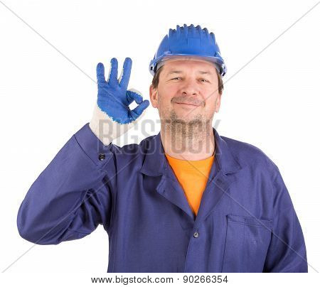Worker shows hand sign okey.