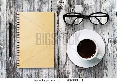 Blank Diary And Coffee Cup On A Vintage Wooden Table, Mock Up