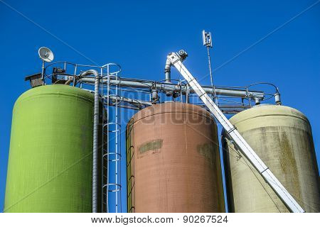 Silos On Blue Background