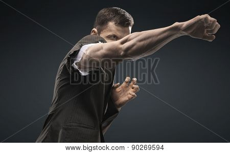 Young businessman as a successful fighter