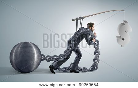 Conceptual image of a businessman pulling a heavy ball