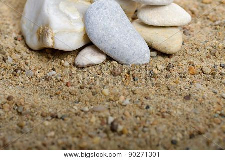 Stack Of Rocks An Sandy Background