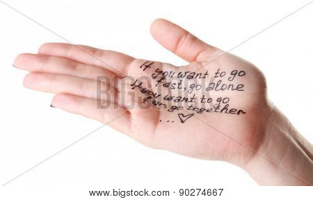 Female hand with written message isolated on white