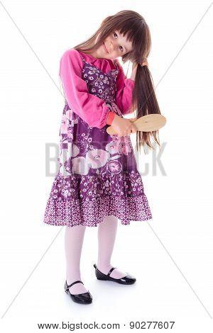 Little Girl Combing Her Long Hair