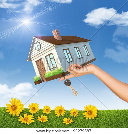 House And Keys In Left Womans Hand